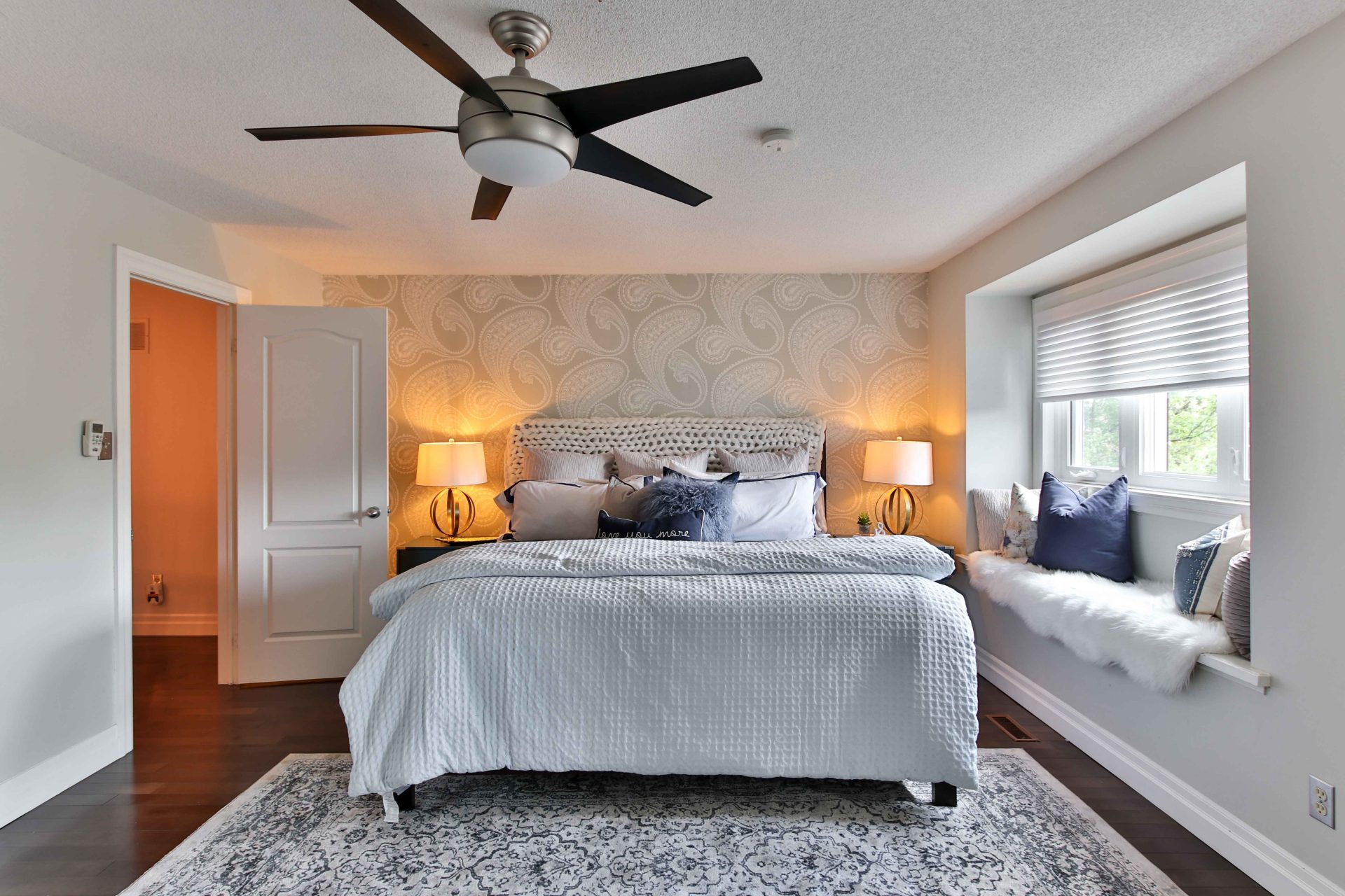pic of bedroom with ceiling fan for a blog about how to get your home cooler